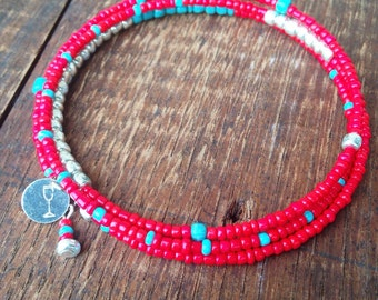 Beaded bangle bracelet with recycled wine cork charm