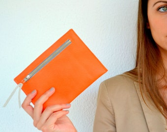 Orange leather pouch with zipper in front