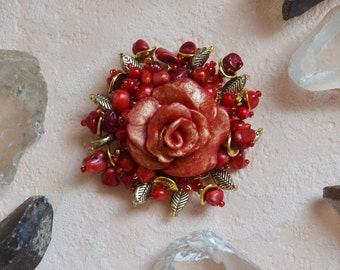 Brooch flower handmade 100% . The brooch is made coral beads, czech  beads,ceramiks flower and metal beads. Brooch on  metal founding.