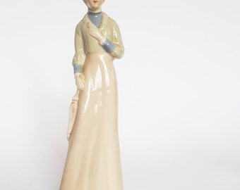 Vintage Figurine of Lady in Gray from the 1920s
