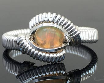 Ethiopian Opal Wire Wrap Ring Argentium Silver and 14 karat yellow gold filled wire wrap designs by Ryan Eure Designs