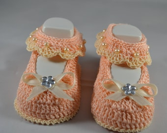 Baby girl booties, light coral and cream