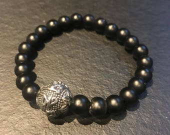 Obsidian beads and Tibetan prayer beads made of stainless steel