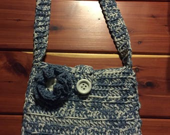 Crocheted purse with flower