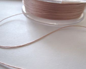 1 meter of 0.38 MM pale pink silk thread