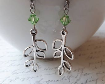 Silver branch earrings with peridot green crystals