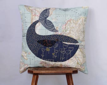 Blue whale cushion cover appliqued onto world map fabric