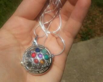 Elephant locket necklace.