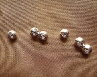 Bead, silver plated brass, 7mm, smooth round, Pack Of 14 beads.