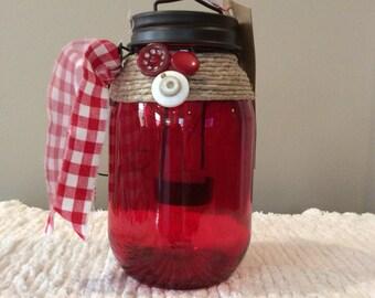 Red glass lantern jar-red gingham-ribbon-brown metal lid-star cutout-hanging lantern-candle-jute-buttons-white-led light-vintage-primitive