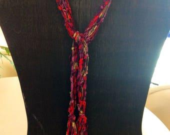 Handknit fringed scarf