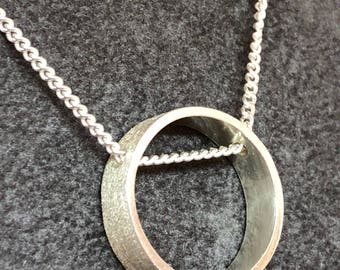 Sterling silver frosted circular pendant