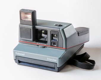 Gray Polaroid Impulse Camera
