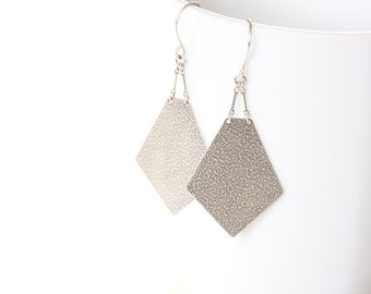 "Modern geometric silver earrings with intricate embossed texture on both sides of the pentagon shape dangle design - ""Artemis Earrings"""