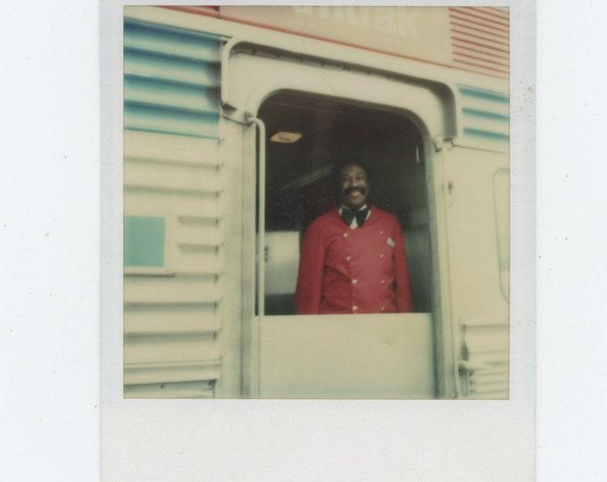 Vintage Polaroid SX-70 Snapshot Photo: Amtrak Porter [86690]