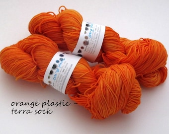 orange plastic  - terra sock, fingering weight sock yarn