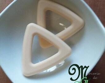 Teething ring. Beige triangle shape.