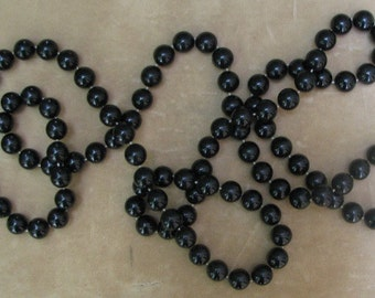 A Matte Black Beaded Eternity Necklace