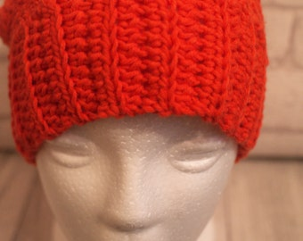 Orange beanie, ponytail, messy bun, crochet hat, joggers,