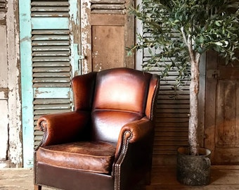Beautiful vintage Dutch leather wingback chair