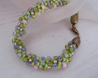 Spring is springing..kumihimo bracelet in sprint pastel colors, price reduced for the holiday!