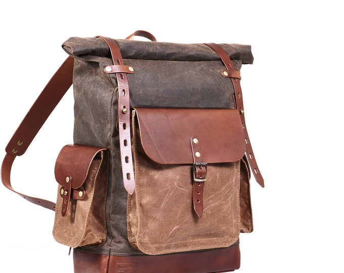 Vintage style waxed canvas roll-top backpack in olive and tan colour.