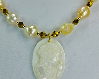 Cameo Carved into White Shell Necklace with Freshwater Pearls and Tiny Cut Glass Beads with tiny Gold Plated Spacer Beads Necklace