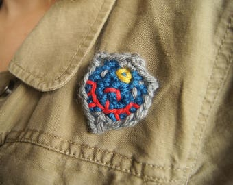 Broche de bouclier d'Hyrule du lien au crochet de The Legend of Zelda