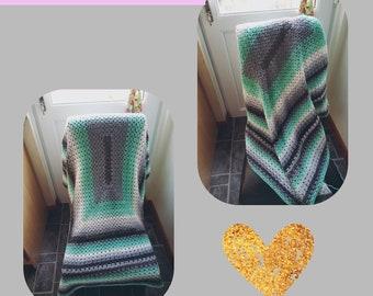 Grey and green crochet throw