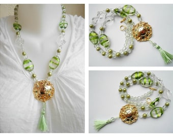 Shield necklace gold rhinestone and transparent green beads.
