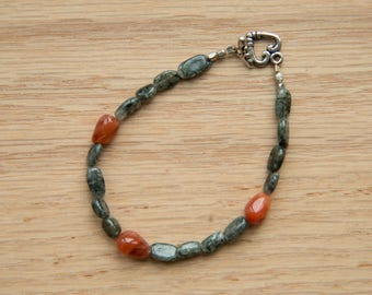 Natural green and red stone bracelet with silver toned toggle