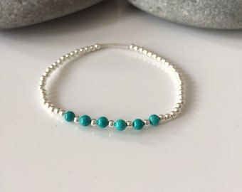Turquoise beaded bracelet. Silver stretch bracelets. Silver and turquoise beaded bracelet. Turquoise Beaded stretch bracelet. Turquoise