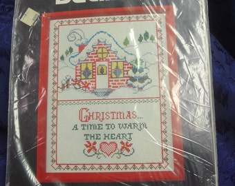 "UNOPENED Bucilla  #48647 ""Warm the Heart''  Christmas Sampler Counted Cross Stitch"