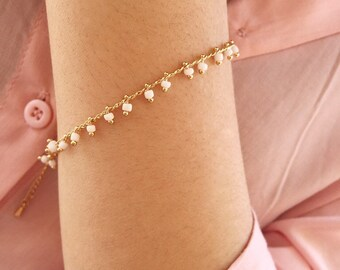 Bracelet with golden brass chain and mini beads