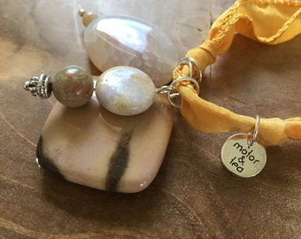 Warm Summerday: an one of a kind silk wrapbracelet of necklace with semi preciousstones. yellow, ochre, orange, white. jasper, agate