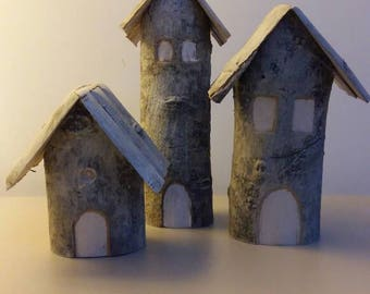 Tris of wooden Houses