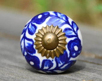 Ceramic knob/cabinet/door handle/white/blue/round/flower/floral/petite/small/drawer pull/decorative/furniture/hardware/dresser/kitchen