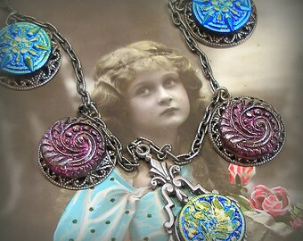 Glass BUTTON necklace, Czech mirrorback glass with flowers, stars & swirls on silver.
