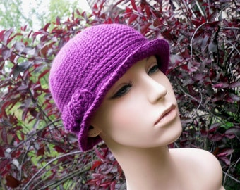 Man-style crochet womens bolero style hat in passion plum