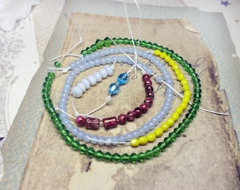 Glass Beads | 6 Strands | 28 Inches Total | Emerald Green Bicones, Blue Moon Translucent ROunds, Tiny Faceted Acid Yellow, Mottled Wine