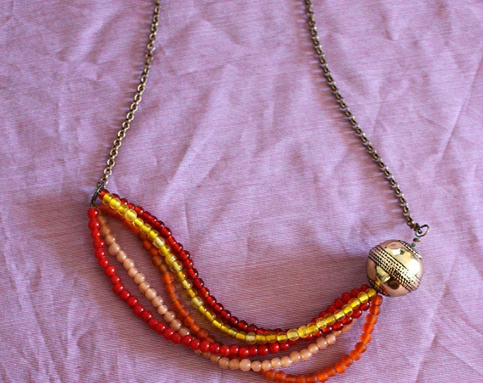 Bib necklace metal beads of Golden and transparent and opaque glass shades of red, yellow, orange, gift for her and nude