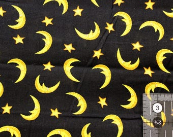 "Golden Moons and Stars on black   44-45"" wide 100% cotton"