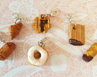 A collection of 5 polymer clay charms pastries