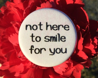 Not here to smile for you / Feminist button