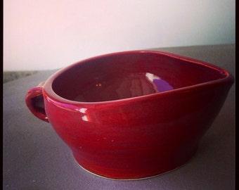Red ceramic creamer or gravy boat