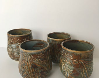 Set of 4 Amber Light Carved Tumblers