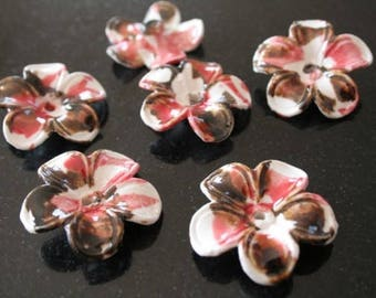 4 flower porcelain beads.   (ref:0696).
