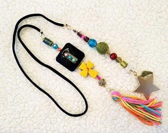 Elastic tassel necklace of semi precious stones, crystals, ceramics and metal