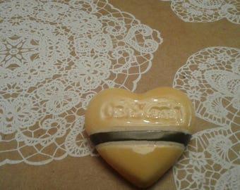 Yellow and Black Ceramic OshKosh Pin