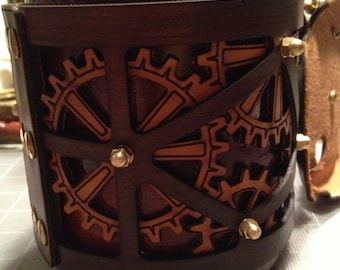 Steampunk styled, decorative leather wraps for large mugs.